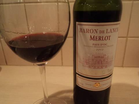Барон де Ланс bottle and glass